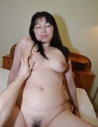 Mature Asian chick Shigeko Yokoi is sucking this pretty horny cock