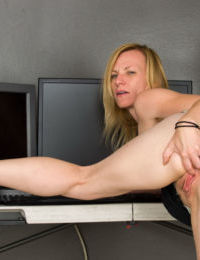 Mature lady Cody Hunter strips naked prior to spreading her asshole