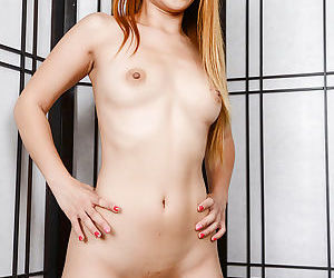 Asian redhead Asia Zo stretches her lovely anal hole with pleasure