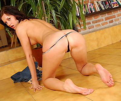 Sweet brunette with perky tits strips down to her bare feet
