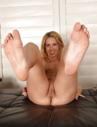 Mature blonde babe Stevie Lix and painted toenails spreading shaved pussy