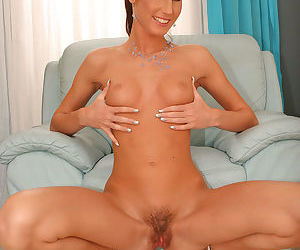 Leggy solo model Josette Most parts the labia lips of her hairy vagina
