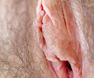 Hirsute model Estella Z strips naked to flash hairy armpits and vagina