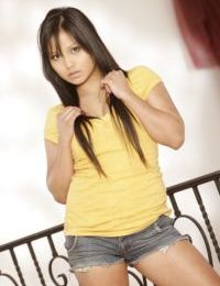 Teen Latina Lana Violet poses in her beautiful high heels on a balcony