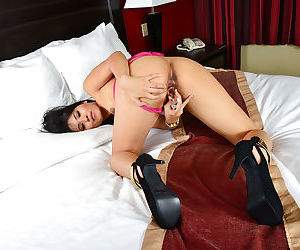 Amateur Asian Angelina Chung is sucking her tasty plastic dildo