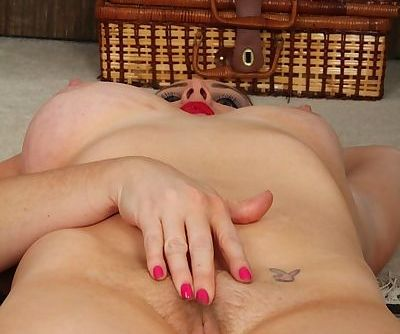 Phoebe Brown reveals her mature pussy while posing in high heels