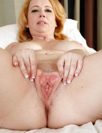 Chunky older redhead woman Brandie Sweet baring big boobs and butt