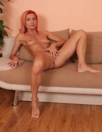 Reckless red-haired mature woman Klarisa Hot pushes her saggy breasts
