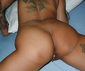 Tatted Thai chick Na spreading butt cheeks for doggy fuck on bed