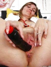 Chubby mature nurse in uniform toying twat during masturbation session