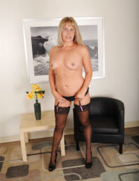 Mature chubby with big booty stripping naked is known as Kayla Larson