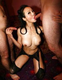 Asian mature Ange Venus enjoys threesome sex in her stockings