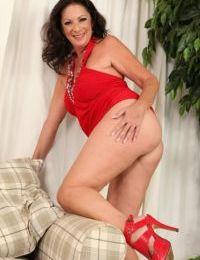 Upskirt masturbating scene features a big tits mature babe Margo Sullivan