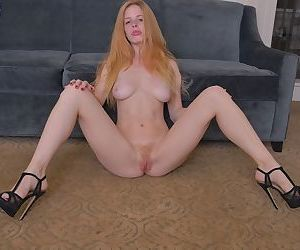 Horny redhead babe Alexia Sirens strips and teases her trimmed beaver