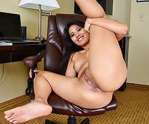 Black-haired Asian babe Angelina Chung spreading her long chubby legs