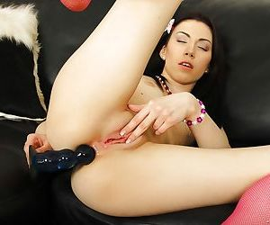 Saucy schoolgirl stripping and pleasing her asshole with a ribbed dildo