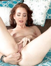 Stocking clad aged redhead Sable Renae baring tiny tits before masturbating