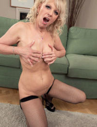 Mature blonde woman does her first DP with 2 younger guys in mesh stockings