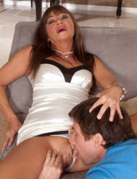 Mature lady Raven introduces a young boy to the art of anal sex
