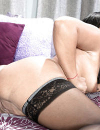 Stocking clad mature brunette Amber Reiz taking anal fingering and fucking