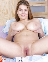 Nude knockout with big natural melons toying her tight love holes