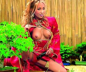 Sexy Asian MILF Bamboo experiences an interracial DP out in the garden
