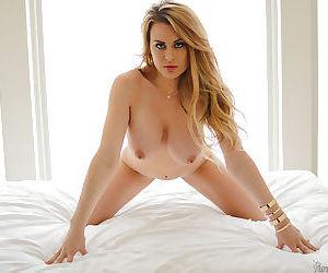 Busty blonde mom Corinna Blake strips down to bra and panties