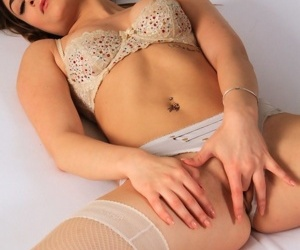 Young solo girl Baby Luu sticks a sex toy up her butthole in stockings