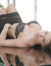 Mature secretary Kitana Lure modeling for babe photo shoot in office