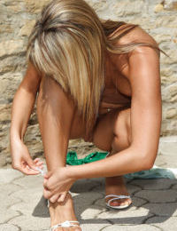 Stunning teenage blonde stripping and masturbating her shaved twat outdoor