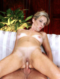 Mature slut Adora gets her pussy and anal hole plowed by a strong pecker
