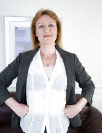 Mature lady Clare Cream undresses and touches her snatch with pleasure