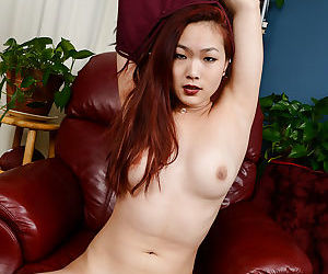 Amateur Asian chick spreads pink pussy wide open in hot close ups