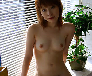 Lovely asian babe Akari Satsuki slipping off their way lacy underclothing