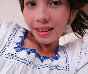 Petite teen Ann gets naked for the first time in front of the cameras.