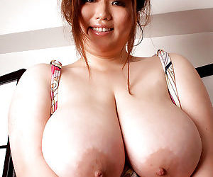 Asian babe with fat tits Riria Misaki goes topless and posing maidenly
