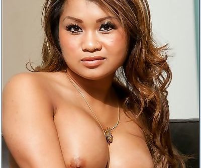 Lovesome asian wife Annie Lee denudes nice breasts and posing on knees