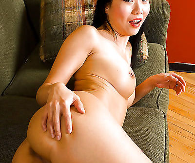 Skinny Asian amateur Niya Yu showing off her nice thong covered ass