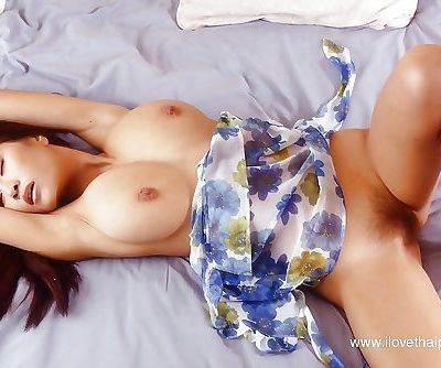 Redhead Asian model shows off her nice big natural boobies on cam