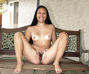 Oriental first timer Mariah exposing smallish tits while undressing outside