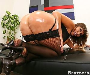 Asian MILF Ava Devine posing provocatively in stockings and heels