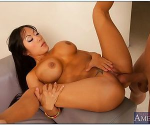 Busty asian babe sucks a huge cock and gets her shaved pussy drilled