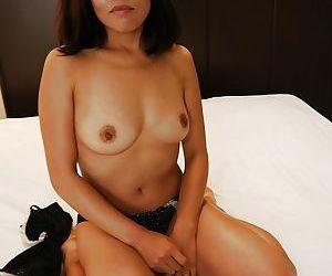Tanned Japanese babe Kayoko Ikehata poses in her black lingerie