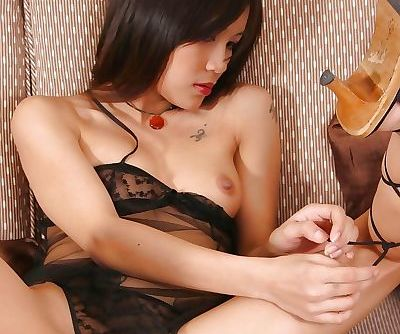 Foot fetish Asian babe licking her fingers before using them to masturbate