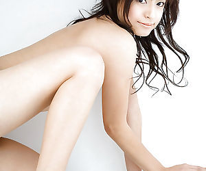 Alluring asian coed on high heels Misaki Mori stripping off her dress