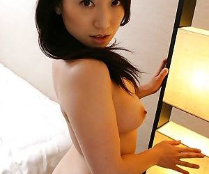 Brunette asian with a cute ass Eriko masturbating that pussy
