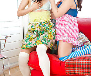 Young Asian girls in knee high socks experience the beauty of lesbian sex