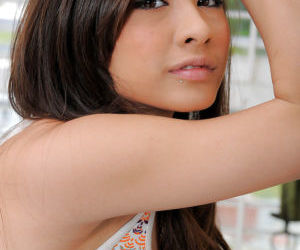 Asian cutie Arial Rose removes blouse to expose big natural breasts