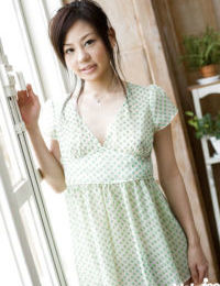 Pretty asian teen babe Takami Hou stripping off her dress