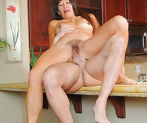 Amateur Asian mom Sakura Lei taking white cock inside hairy pussy